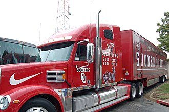 Road (sports) - Oklahoma Sooners transport truck carries team equipment for road games.