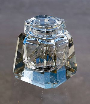 Old scratched glass inkwell