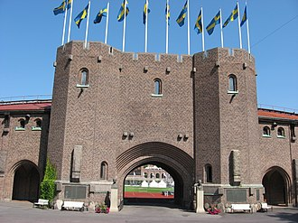 The front gate of the Stockholm Olympic Stadium, which was built for the 1912 Games Olympiastadion Stockholm front.jpg