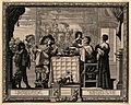 People eating and drinking before a tapestry. Wellcome V0007679.jpg