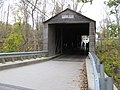 People walking on the old Bulls Bridge. This is one of the famous old covered bridges of New England, having been built in 1842. - panoramio.jpg