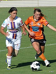 Raso (right) playing for Brisbane Roar in 2014