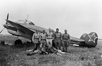 Petlyakov Pe-2 - Soviet pilots and ground crew pose in front of a Pe-2 light bomber at Poltava, June 1944.