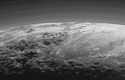 Pluto's Majestic Mountains and Frozen Plains.jpg