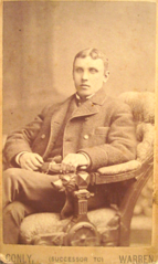 Portrait of young man in chair by Conly of Boston USA.png
