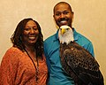 Posing for picture with Bald Eagle. (10594614304).jpg