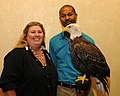 Posing for picture with Bald Eagle. (10594648396).jpg