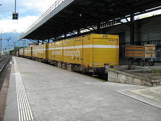 Mail - Postal wagons at the postal sorting facility in Sion, Switzerland. Mail between regional cities is transported by rail, to be delivered by postal bus, vans and cycles at a local level.