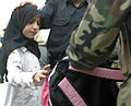Provincial Reconstruction Team, Iraqi Security Forces spread smiles to Iraqi children DVIDS131779.jpg