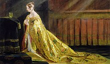 Demure young Victoria kneeling before a gold communion cup and wearing a gold robe decorated with roses, thistles and shamrocks