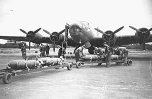 "RAF Bovingdon - Ground crew of the 92nd Bomb Group load bombs into a B-17 Flying Fortres (AAF Ser. No. 41-9148) nicknamed ""Boomerang"" at Bovingdon, 17 October 1942."