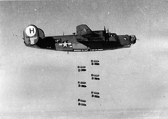"""RAF Bungay - A B-24J-95-CO Liberator (""""Lil' Max"""", JU-M, serial number 42-100347) of the 707th Bomb Squadron, 446th Bomb Group dropping bombs on Gotha, Germany from 17,000 ft, 20 February 1944."""