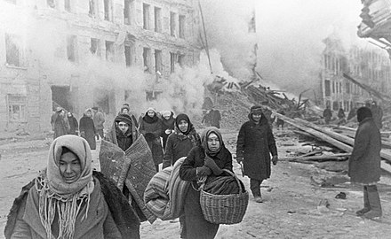 Soviet civilians leaving destroyed houses after a German bombardment during the Battle of Leningrad, 10 December 1942 RIAN archive 2153 After bombing.jpg
