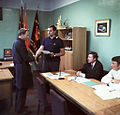 RIAN archive 730407 Komsomol Committee Secretary Gorodetsky handing over a merit certificate to Mikhailov, mechanic of press room number one.jpg