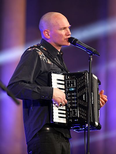 Rainer von Vielen-Heimatsound playing a Roland digital V-Accordion. The bank of electronic switches can change the accordion's sound, tone and volume. Rainer von Vielen-Heimatsound-2015 (12).jpg
