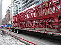Removing the big boom crane from atop the almost finished reconstruction of the old National Hotel, 2015 03 07 (20) (16758049381).jpg