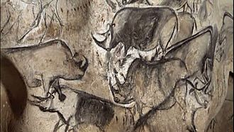 Cave painting - An artistic depiction of a group of rhinoceros, was completed in the Chauvet Cave 30,000 to 32,000 years ago.