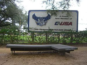 Rice Track/Soccer Stadium - Rice Track/Soccer Stadium behind fence and sign.