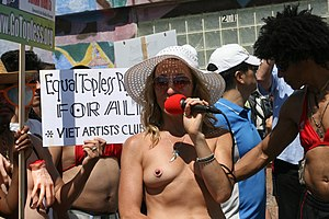Pasties - A group of people protesting for equal rights for women to go topless, with the demonstrator wearing a pastie in the shape of a nipple