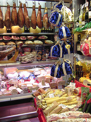 Array of meats, cheeses and bottles