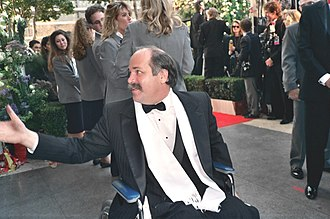 Born on the Fourth of July (film) - Ron Kovic attending the 62nd Academy Awards on March 26, 1990. He and Stone received an Oscar nomination Best Adapted Screenplay, and won a Golden Globe Award for Best Screenplay twenty-two years the day he was injured.