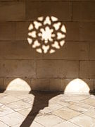 Rose window shadow Alcobaça Monastery.jpg