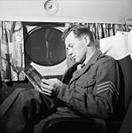 SAS DC-4 cabin with soldier reading.jpg