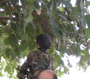 Child murder - A child soldier of the Sudanese People's Liberation Army (2007).