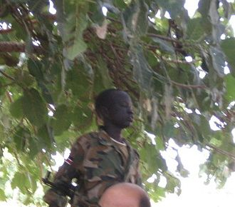 Children in the military - A child soldier of the Sudanese People's Liberation Army (2007).