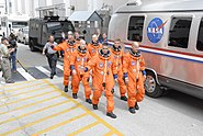 STS117 Crew head to AstroVan