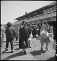 San Bruno, California. Families of Japanese ancestry arrive at assembly center at Tanforan Race Tra . . . - NARA - 537493.tif