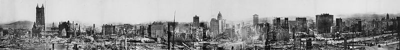 Panoramic view of earthquake and fire damage from Stanford Mansion site, April 18–21, 1906. Note the ruins of the original City Hall building at far right.[81]
