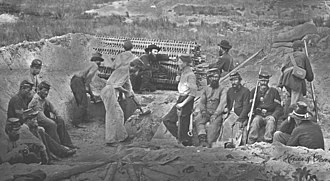 Sapping - Union troops of the 1st New York Engineers digging a sap with a sap roller on Morris Island, 1863