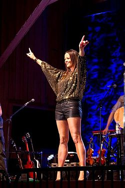 Sara Evans on stage, gold shirt.jpg
