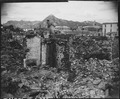 Scene of war damage in residential section of Seoul, Korea. The capitol building can be seen in the background (right). - NARA - 531379.tif