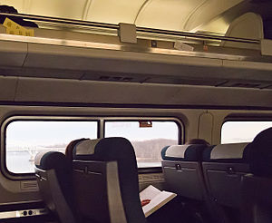 Train ticket - Seat checks above the heads of the passengers, on an Amtrak train (Northeast Regional) in 2012.