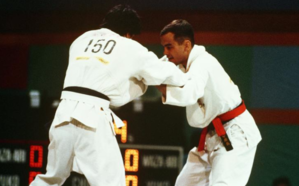 Craig Agena - Craig Agena, right, competes against Norway's Alfredo Chinchilla in the 65 kilogram weight class of the judo event at the 1984 Summer Olympics.