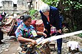 Secretary Kerry Examines Goods Made By a Textile Worker (8971071525).jpg
