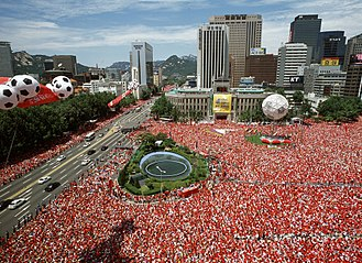 South Koreans watching their nation on the big screens in Seoul Plaza during the 2002 World Cup Seoul Plaza 2002 FIFA World Cup.jpg