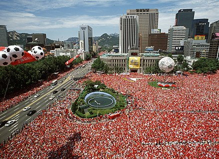 South Koreans watching their country playing in a knock out game on the big screens in Seoul Plaza Seoul Plaza 2002 FIFA World Cup.jpg