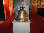 Ships bell from HMS New Zealand in June 2012.JPG