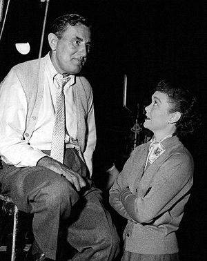Sidney Lanfield - Lanfield and Jane Wyman confer on the set of Fireside Theater, 1955