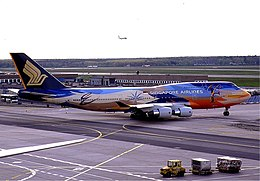 Singapore Airlines B747-400 (9V-SPK) in Tropical livery.jpg