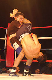 A fighter attempts to escape from an armbar by slamming the opponent to the ground.