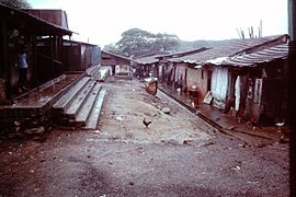 Slums-of-Mumbai-1979-Open-space-gutter-cock-steps-IHS-87-14.jpeg
