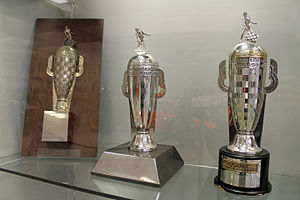 Borg-Warner Trophy - Trophy replicas; the award on the left was given to winners from 1936 to 1987. The award in the center is the current trophy replica presented to the winning driver.