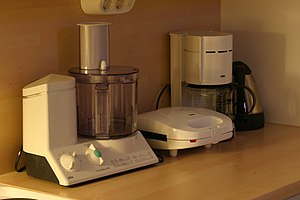 Small appliance - Small appliances in a kitchen: a food processor, a waffle iron, a coffee maker, and an electric kettle