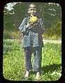 Smiling boy holding a baseball, China, ca. 1918-1938 (MFB-LS0242).jpg