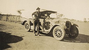 Arthur Upfield - Snowy Rowles, convicted for The Murchison Murders, standing beside the car of James Ryan, photographed by Arthur Upfield. Ryan was one of the victims.