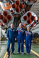 Soyuz TMA-14M crew in front of their booster rocket.jpg